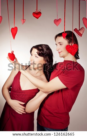 Mature couple of lovers. Man presents flower