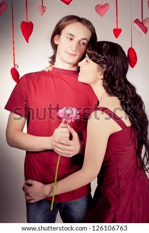 Mature couple of lovers. Man presents flower. Handmade hearts