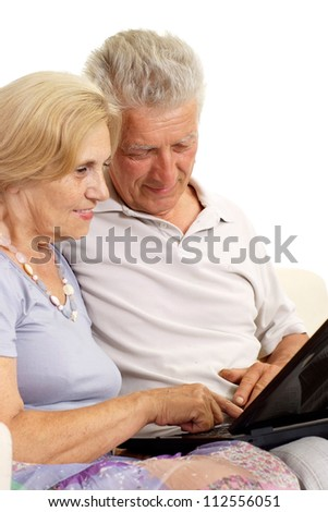 Mature couple relaxing at home on a white background