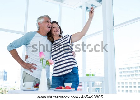 Mature couple taking selfie at restaurant #465463805