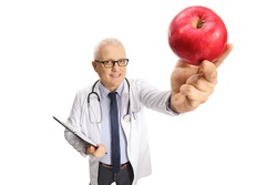 Mature doctor holding a clipboard and a red apple isolated on white background