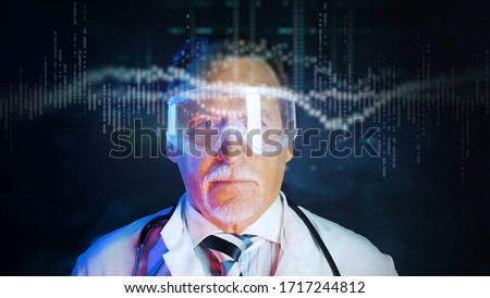 Mature doctor in protective glasses on dark background. Close up portrait elderly scientist in high tech laboratory. Handsome doctor in protective glasses looking at augmented reality screen. Foto stock ©