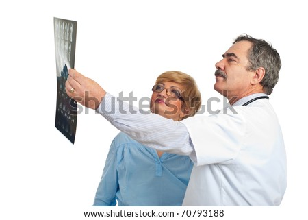 Mature doctor man showing to his patient woman the results of MRI and discussing together isolated on white background