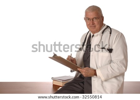 Mature doctor sitting on a desk with a white background