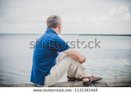 Mature European man with a sad philosophical mood. The concept of life after 50 years, problems and depression. Crisis of middle age #1135385468