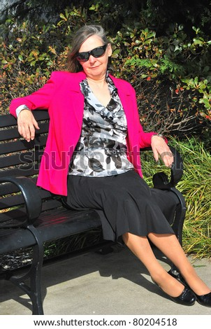 Mature female beauty relaxing outdoors.