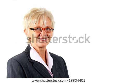 Mature Female Manager A businesswoman in her fifties with glasses and a suit. Isolated over white.
