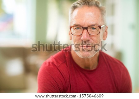 Mature fit handsome man smiling. Photo stock ©