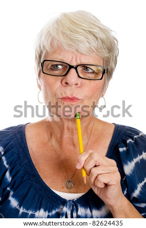 Mature gray haired woman struggling to remember something.