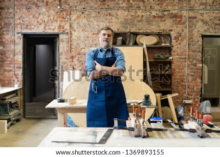 Mature handsome joiner work in carpentry. He is successful entrepreneur at his workplace Photo stock ©