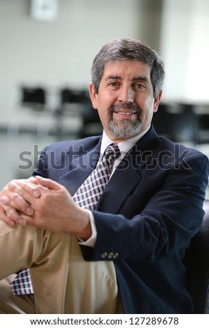 Mature Hispanic businessman inside an office building