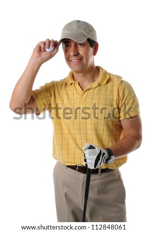 Mature Hispanic golfer saluting isolated on a white background