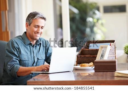 Mature Hispanic Man Using Laptop On Desk At Home #184855541