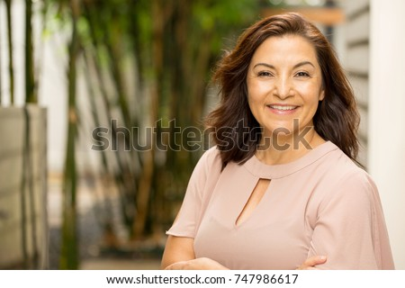 Mature Hispanic woman smiling.