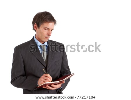 Mature inspector writing some notes - stock photo