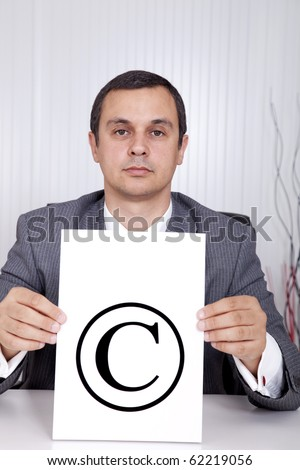 mature lawyer businessman holding a copyright symbol