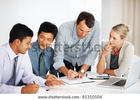 stock photo : Mature male leader with multi ethnic business team working ...
