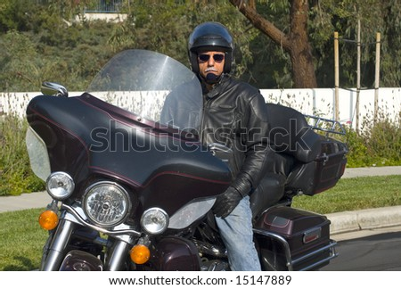 mature male rider on touring motorcycle