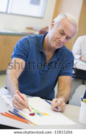 Mature male student in art class