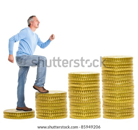 Mature man climbing a stair made of money