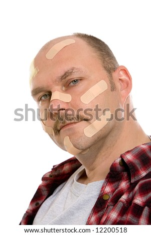 Mature man covered in bandaids all over his face