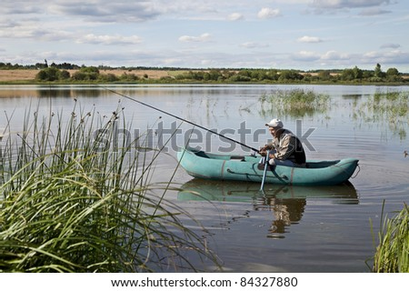 Mature Man Fishing From a inflatable boat