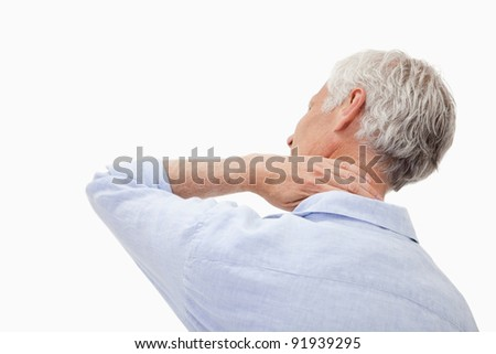 Mature man having a neck pain against a white background