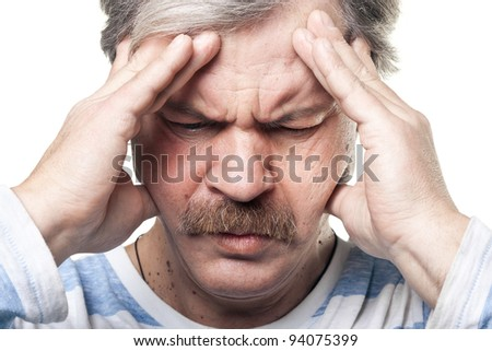 mature man having very strong pain and holding head in hands isolated on white