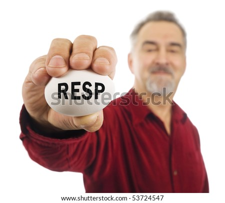 Mature man holds a white nest egg with RESP (Registered Education Savings Plan popular in Canada) on it.