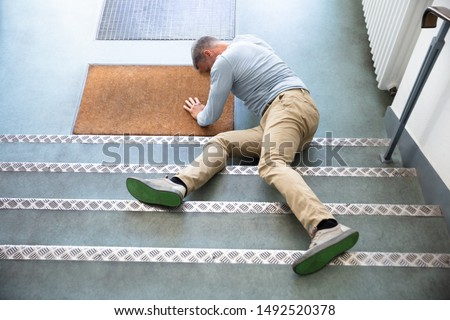 Mature Man Lying On Staircase After Slip And Fall Accident Stock photo ©