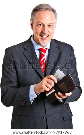 Mature man paying a bill