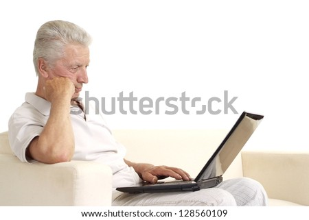 Mature man relaxing at home on a white background