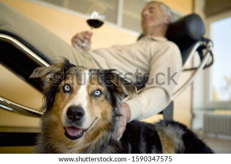 Mature man relaxing with dog