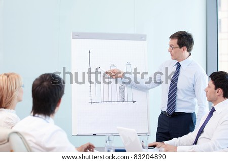 Mature man shows a graph of the staff