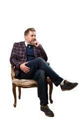mature man sitting on a sofa