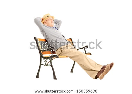 Mature man sitting on a wooden bench isolated on white background