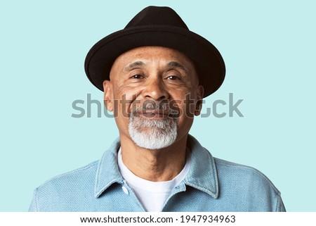 Mature man smiling face closeup portrait on blue background Stock photo ©
