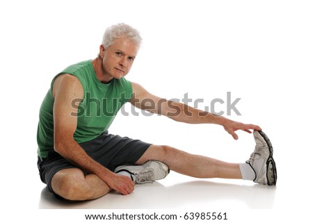 Mature Man stretching and working out isolated on a white background