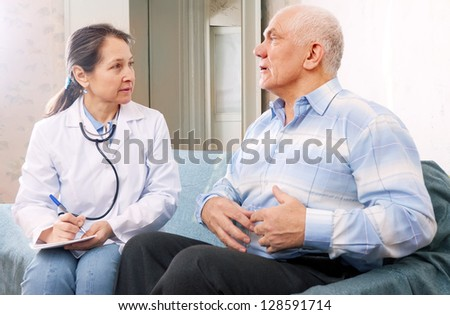 Mature man tells the doctor the symptoms of malaise on couch