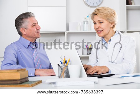 Mature man visits doctor in hospital for consultation on health and treatment  #735633397