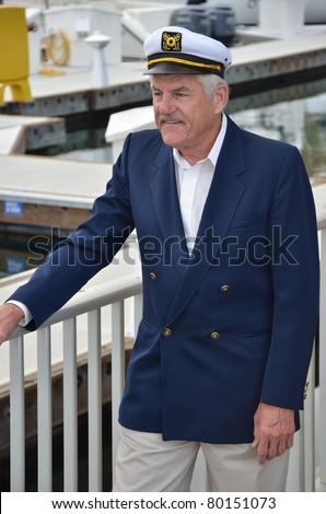Mature man wearing captain hat/Seaman Captain/Portrait of a gentleman wearing a captain hat