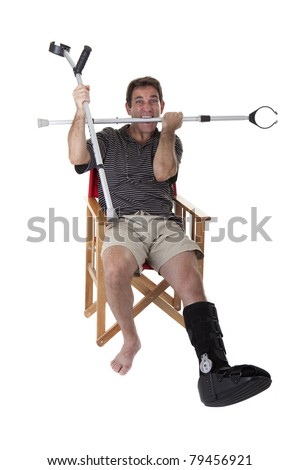 Mature man with broken legs, with crutches, and showing a boring expression