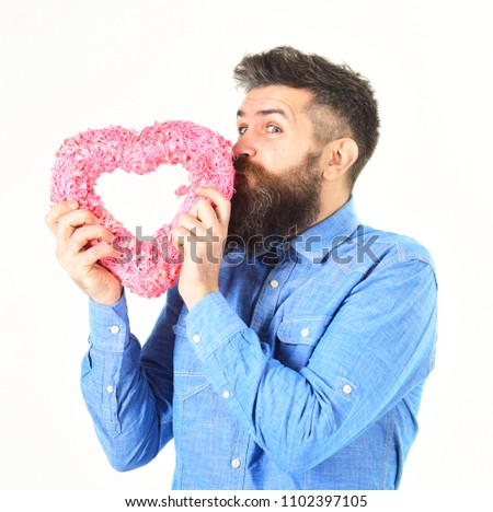 Mature man with long beard holds pink valentine heart on white background. Valentine heart concept. #1102397105