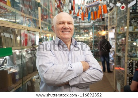 Mature manager  in  auto parts store