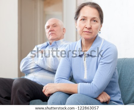 Mature married couple having quarrel at home