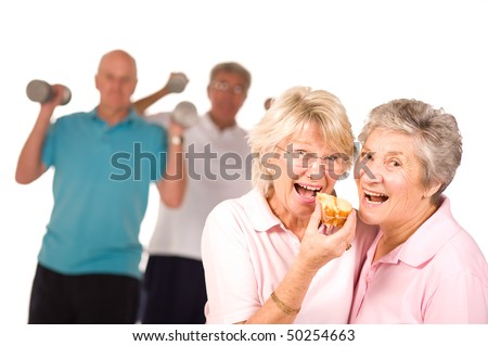 stock photo : Mature older ladies eating cake with partners working out in ...