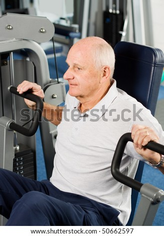 stock photo mature older man working out in the gym 50662597 I was watching some of the Olympics last night and watched Michael Phelps ...