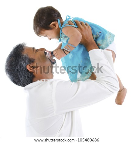 Mature traditional Indian father raise her baby girl up, isolated on with background