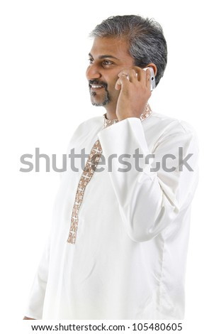stock photo mature traditional indian man talking on mobile phone isolated on white background 105480605 mississauga sensual massage