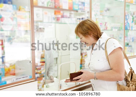 Mature woman buys drugs at the pharmacy